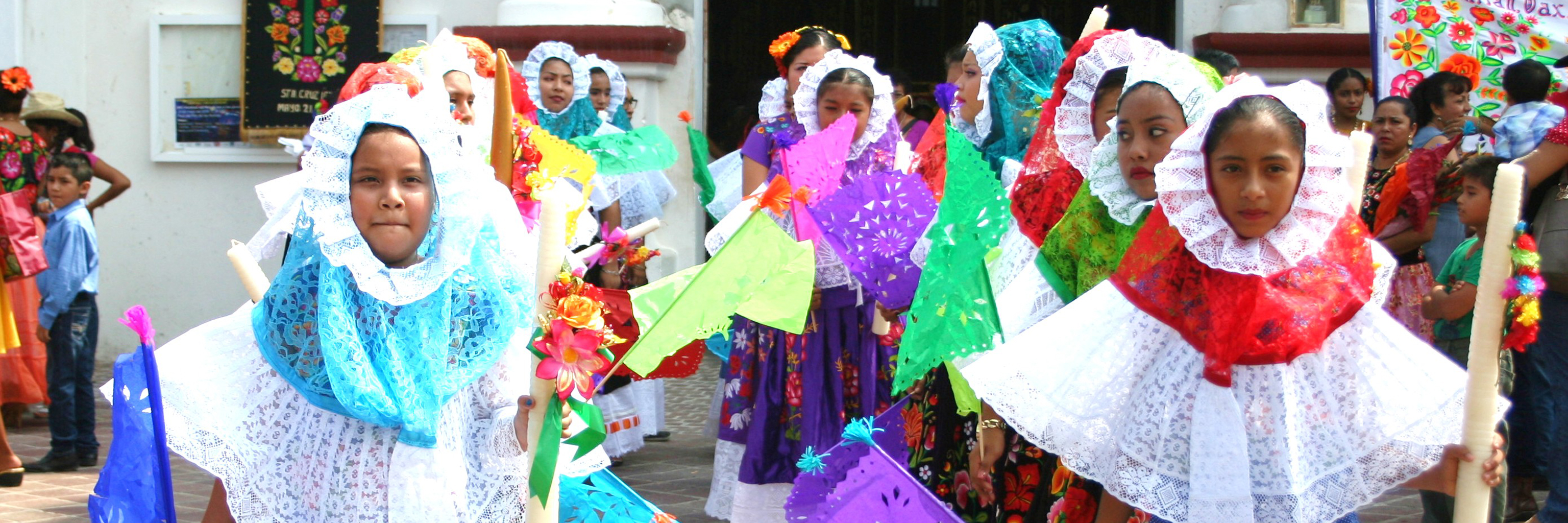 Lines of kids dressed in colorful cultural wear