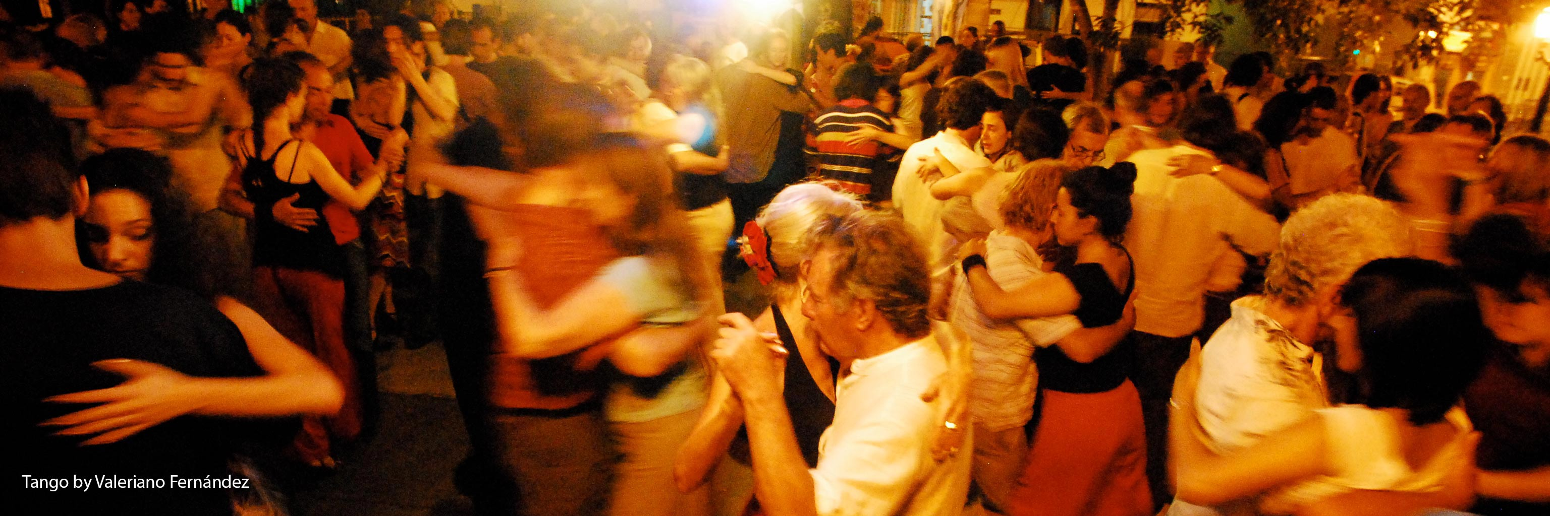 A crowd of people dancing
