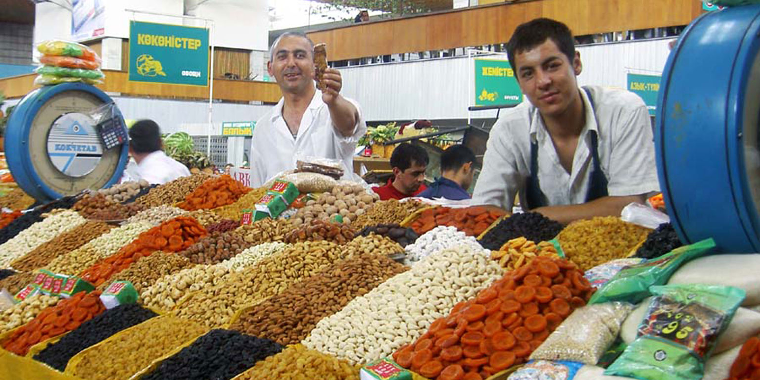 Two men working in a market