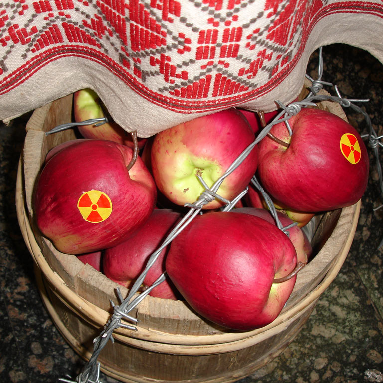 A basket of apples lying on the floor