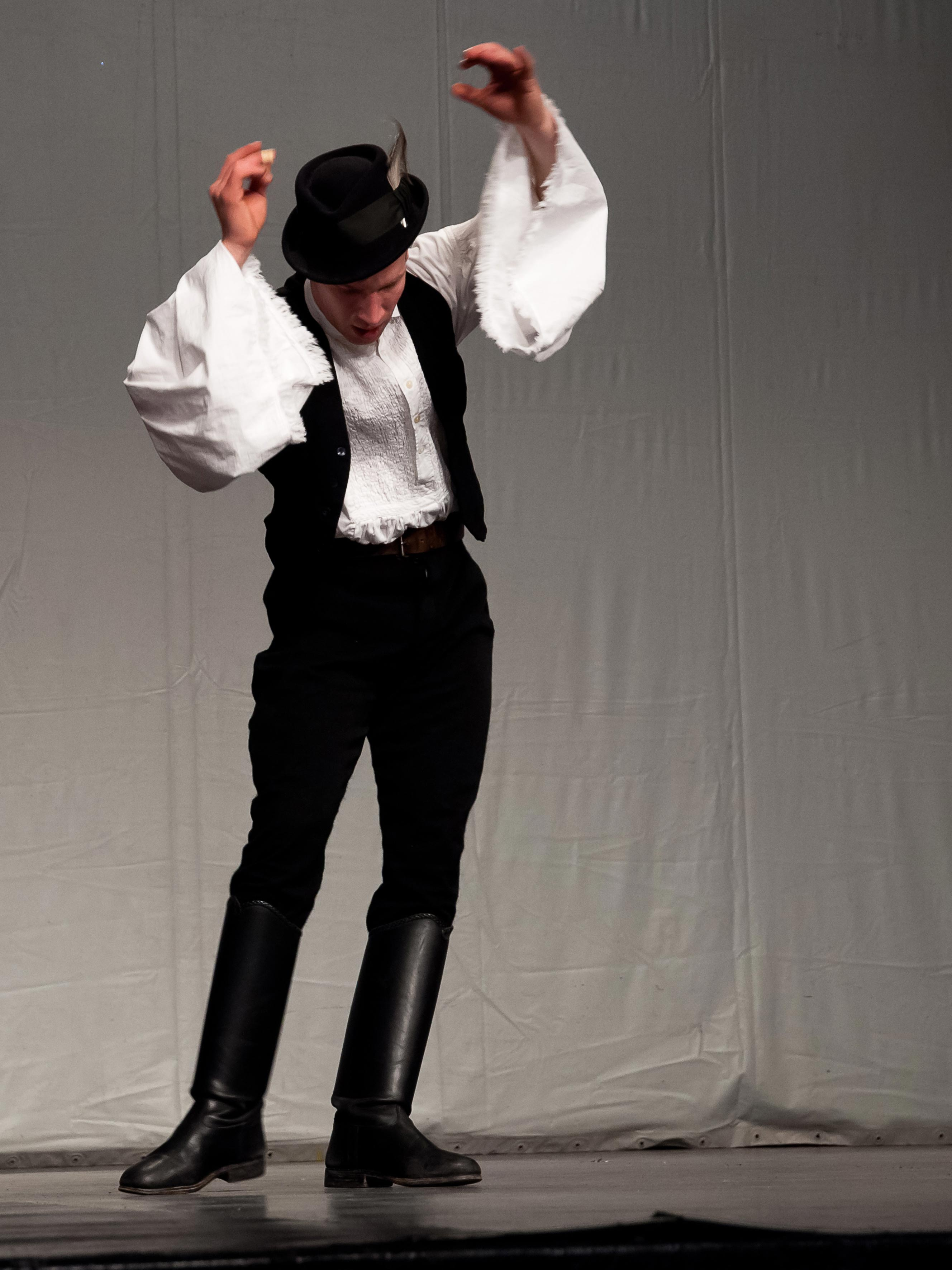 A male dancer performing on stage