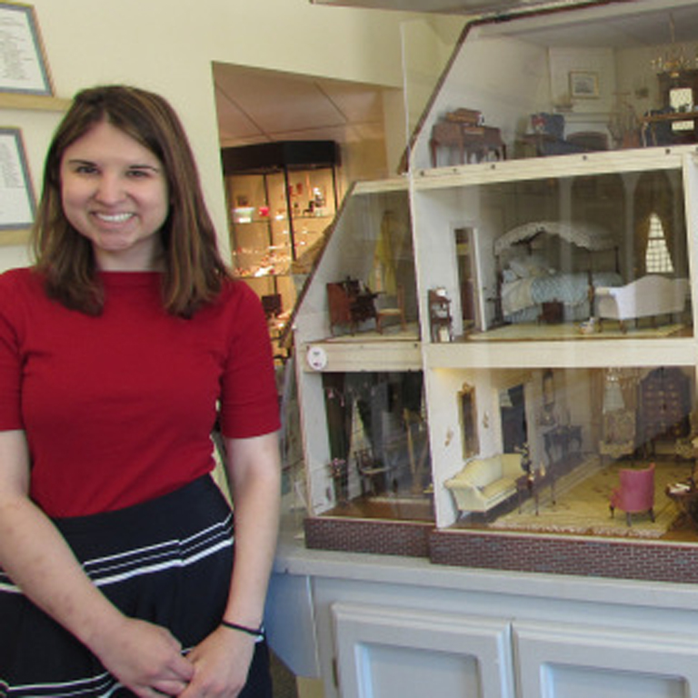 "Rachel Tavaras shows off the ""Yellow Georgian,"" an assemblage of objects in the collections of the Museum of Miniature Houses in Carmel, Indiana."