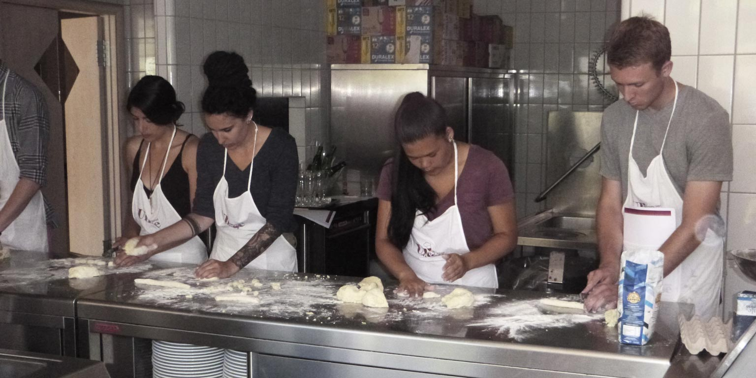 People working with dough on a table