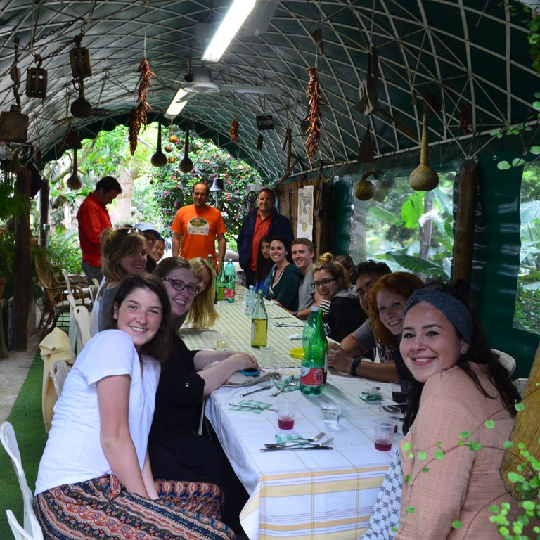 A group of people sitting around a long table
